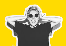 Stylish fashion blonde with short hair colorful collage. Crazy girl in a black t-shirt and rock sunglasses scream Royalty Free Stock Photos