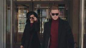 Stylish couple exits from mall stock video