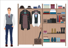 Stylish fashion man and men`s wardrobe. Vector Men`s dressing room design. Clothes and shoes on hangers. Royalty Free Stock Photo