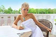 Stylish fashion model in a restaurant outdoors Royalty Free Stock Photography
