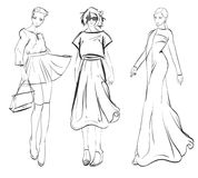 Stylish fashion models. Fashionable girls Sketch. Set of fashion girls on a white background Royalty Free Stock Photography