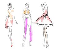 Stylish fashion models. Fashion girls set. Fashion illustration. Stylish fashion models. Fashion girls set. Sketch. Girls in a dress and suit Royalty Free Stock Photo