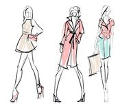 Stylish fashion models. Fashion girls set. Fashion illustration. Stylish fashion models. Fashion girls set. Sketch. Girls in a dress and suit stock illustration