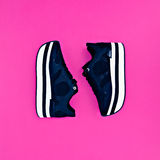 Stylish fashion sneakers on pink background Royalty Free Stock Photography