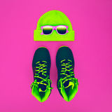 Stylish fashion sport accessories: sneakers, sunglasses, hat on Stock Image