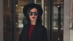 Stylish woman exits from mall stock video