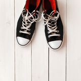 Stylish fashionable black shoes on a white wooden background Royalty Free Stock Images