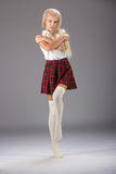 Stylish fashionable blonde woman in white shirt and plaid skirt Stock Photo
