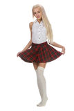 Stylish fashionable blonde woman in white shirt and plaid skirt Royalty Free Stock Photo