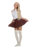 Stylish fashionable blonde woman in white shirt and plaid skirt Royalty Free Stock Photos