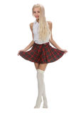 Stylish fashionable blonde woman in white shirt and plaid skirt Stock Image