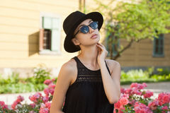 Stylish fashionable brunette beauty outdoors. Stock Image
