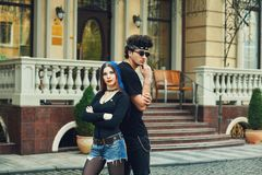 Stylish fashionable young couple in the city. Young people in the city Stock Photos