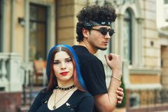 Stylish fashionable young couple in the city. Young people in the city Royalty Free Stock Images