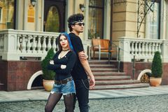 Stylish fashionable young couple in the city. Young people in the city Stock Photography
