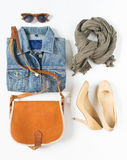 Stylish female clothes set. Woman/girl outfit on white background. Blue denim jacket, gray scarf, vintage crossbag, cream shoes an Stock Images