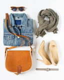 Stylish female clothes set. Woman/girl outfit on white background. Blue denim jacket, gray scarf, vintage crossbag, cream shoes an Royalty Free Stock Photography