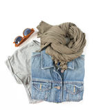 Stylish female clothes set. Woman/girl outfit on white background. Blue denim jacket, gray t-shirt, scarf and retro sunglasses. Fl stock photos