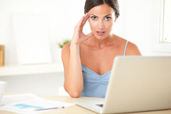 Stylish female feeling tension at work Royalty Free Stock Photography