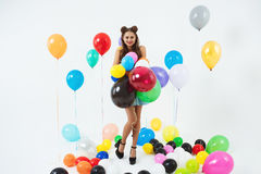 Stylish female hipster posing with big balloons on white Royalty Free Stock Photo