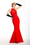 Stylish female in long red fashion dress posing Royalty Free Stock Photo