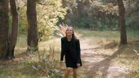 Stylish female tourist enjoy the beautiful landscape of forest,trendy woman traveler orienteering while hiking in forest. Stylish female tourist enjoy the stock video footage