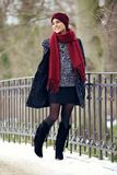 Stylish Female Walking in a Winter Park Royalty Free Stock Photos