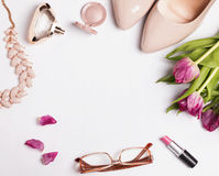 Stylish feminine acessories and pink tulips Royalty Free Stock Photography