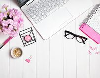 Stylish feminine workplace. With flowers, top view royalty free stock photos