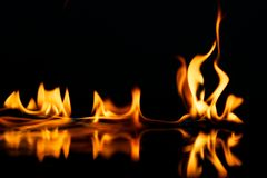 Stylish fire flames reflected in water Stock Images