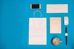 Stylish flat lay composition with shopping bag on color background royalty free stock images