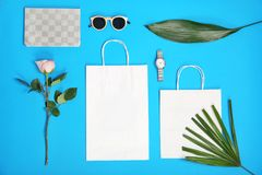 Stylish flat lay composition with shopping bags Stock Photos