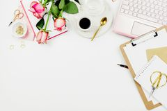Stylish flatlay frame arrangement with pink laptop, roses, glasses and other accessories on white. Feminine business mockup, copyspace stock photos