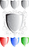 Stylish Floral Shield. Shiny Shields with decorated with floral or scroll pattern in silver, red, blue and green themes vector illustration