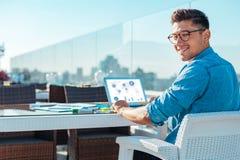 Stylish freelancer looking into camera with smile Royalty Free Stock Image