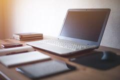 Stylish freelancer workspace with laptop open Stock Photos