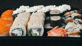 Stylish fresh sushi set with various kinds of sushi rolls, close up. View stock video