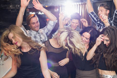 Stylish friends dancing and smiling Stock Images