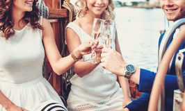 Stylish friends having fun on a yacht Stock Images