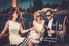 Stylish friends having fun on a yacht Stock Image