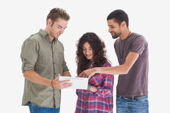 Stylish friends looking at tablet. On white background Stock Images