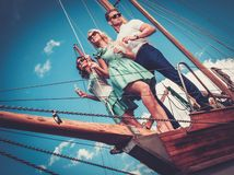 Stylish friends on a luxury yacht Stock Images