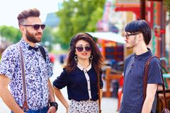 Stylish friends talking on city street Royalty Free Stock Images