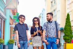 Stylish friends walking the city street Royalty Free Stock Image