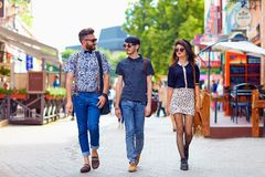Stylish friends walking the city street Stock Images
