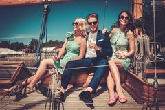 Stylish friends on a yacht Stock Photos
