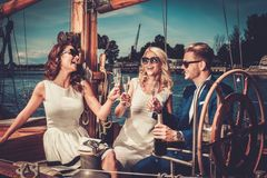 Stylish friends on a yacht Stock Photo