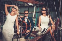 Stylish friends on a yacht Royalty Free Stock Photos