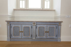 Stylish furniture chest under the window stock photography
