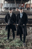 Stylish gangsters men, posing on background of railway. england in 1920s theme. fashionable brutal confident group. atmospheric  m. Oments. space for text Royalty Free Stock Photos